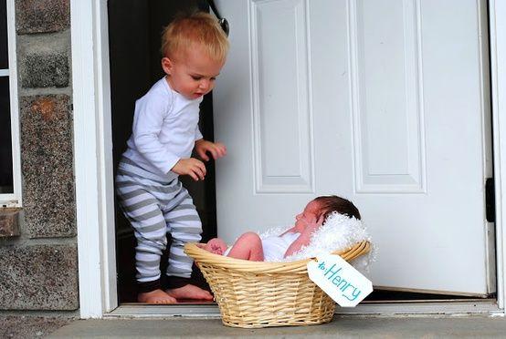Toddler Opening Door to Find Baby